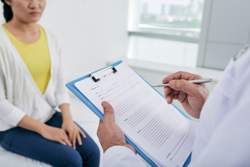 Doctor taking notes on patient's medical history