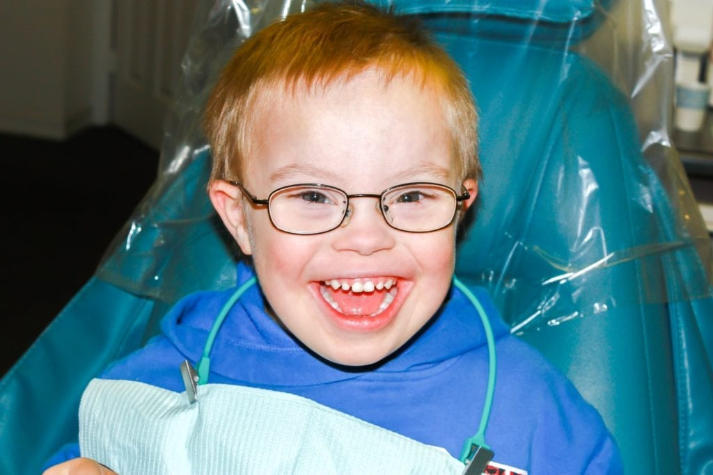 Little boy smiling in the dental chair