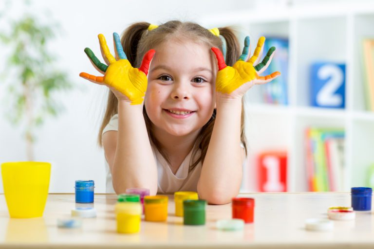 kid girl with face and hands painted at home - Yassin Pediatrics
