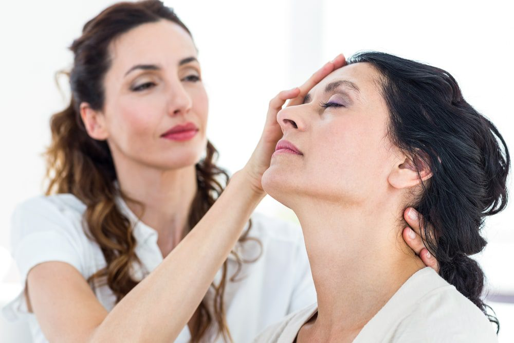 Hypnotherapist using hypnosis to relax a patient
