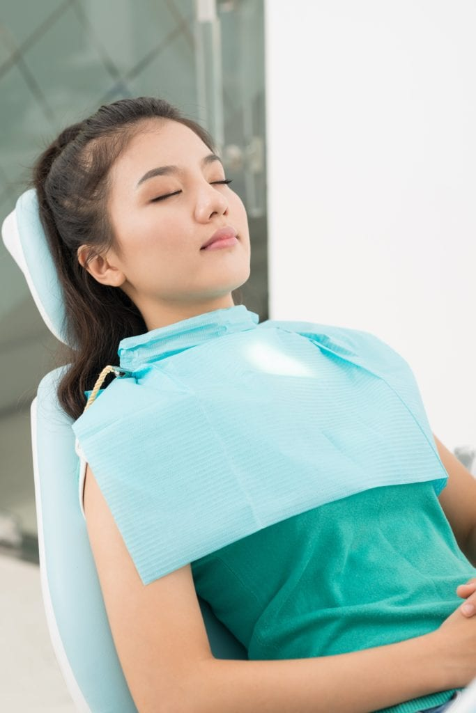 Woman sleeping in dental chair