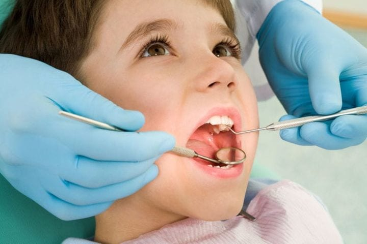 Small boy having dental checkup