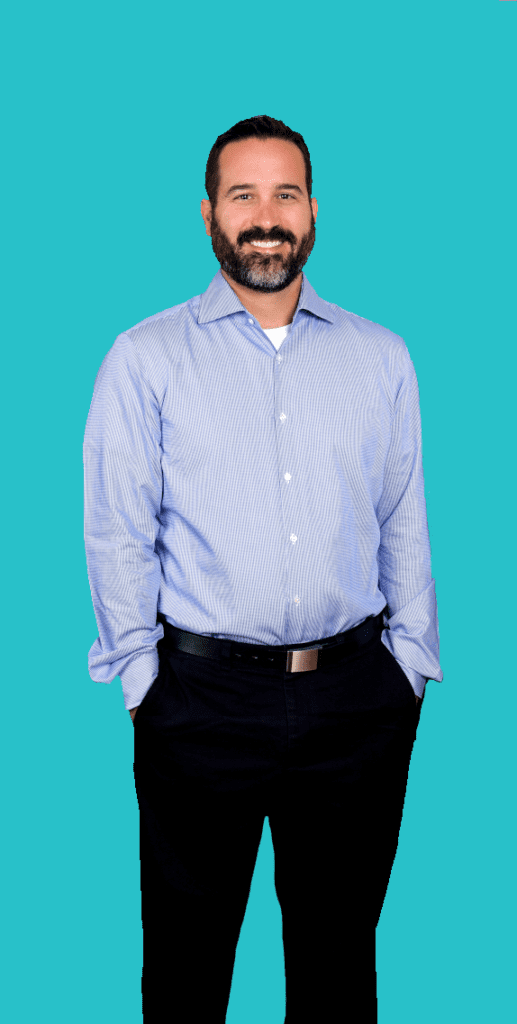 Dr. Micheal Shuck standing against a blue background