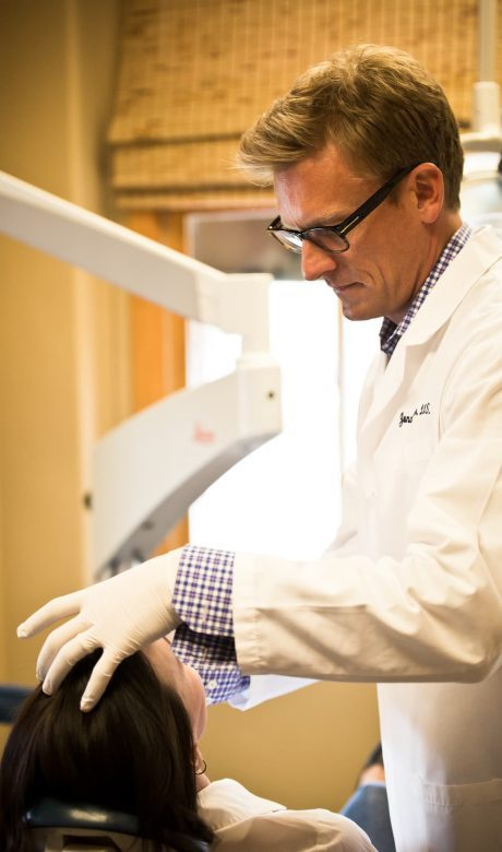dr. haerter working with patient on cosmetic appearance