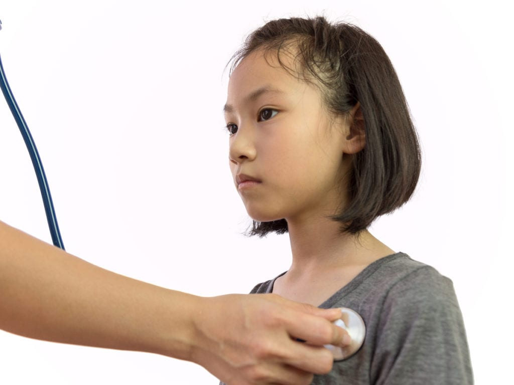 Child receiving care from a physician