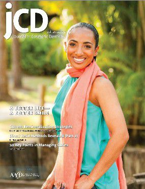 Woman in a teal dress and pink scarf smiling beautifully on the cover of a magazine