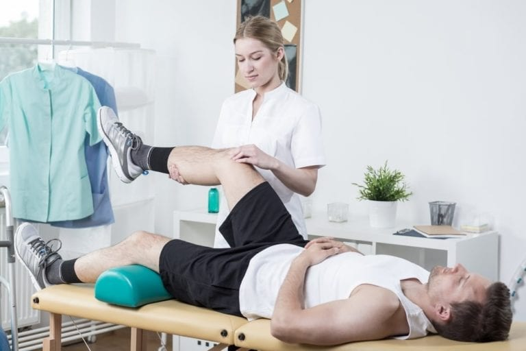 doctor with athlete physical recovery
