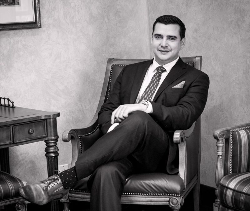 Black and White image of Dr. Falcon seated in a chair