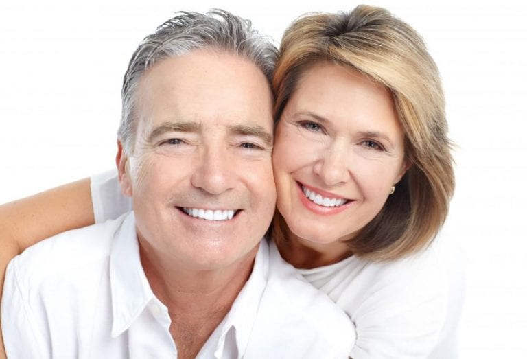 man and woman smiling white background